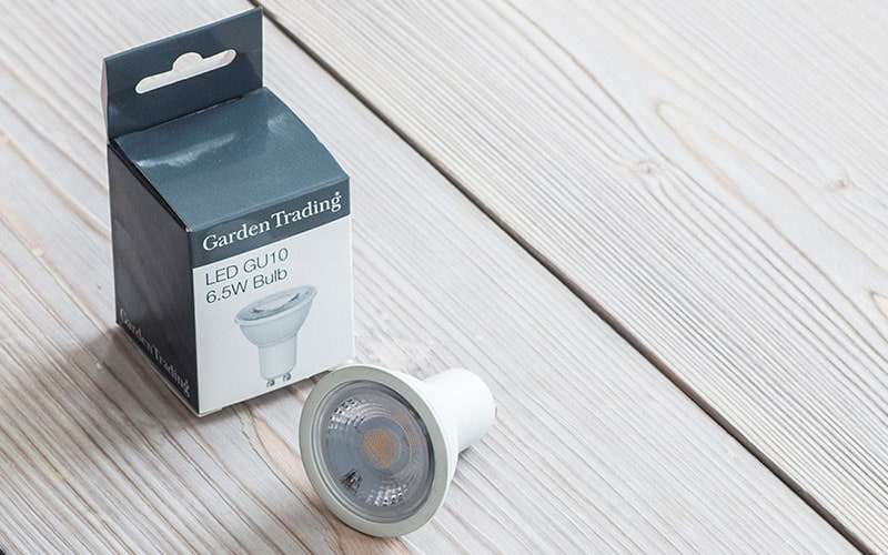 LED light bulb next to box on a wooden floor