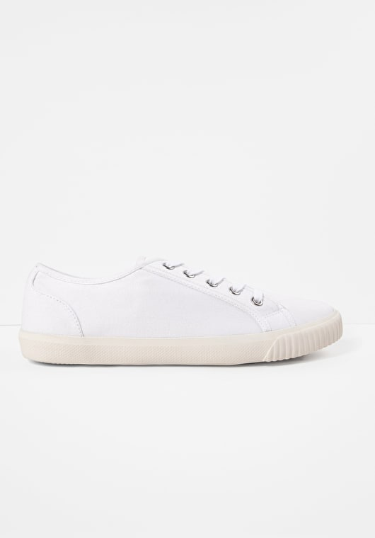 White Canvas Trainers which include metal eyelets, woven laces and ribbed rubber soles.