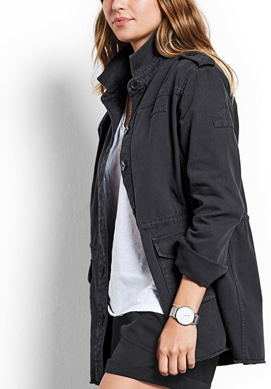 Model wears our long length military jacket in our stunnig washed black with epaulettes on the shoulders