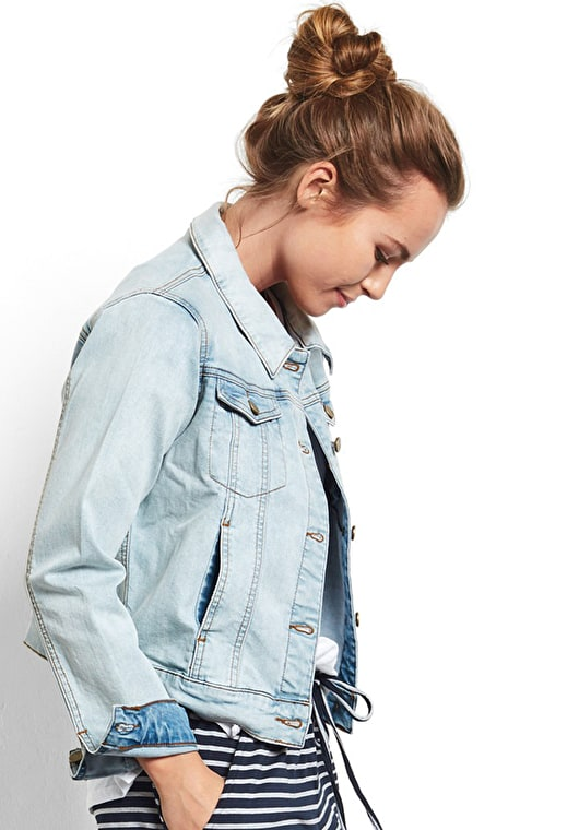 Model wears our soft and lightweight denim jacket in a stunning light denim