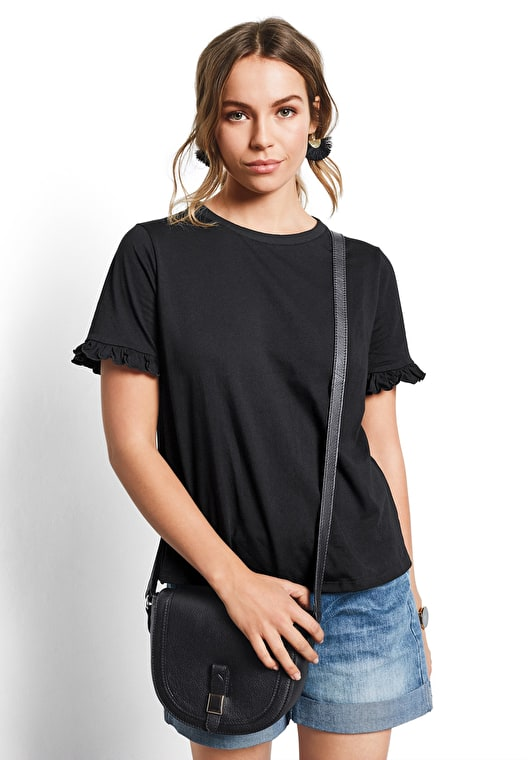 Model wears our Black tee with frilled short sleeves