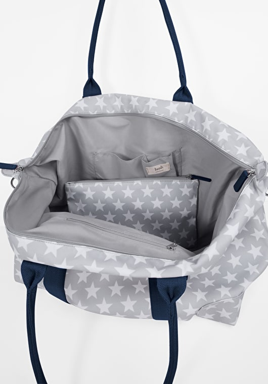 Grey and white star canvas holdall bag with midnight handels and with a detatchable strap and a matching zip pouch