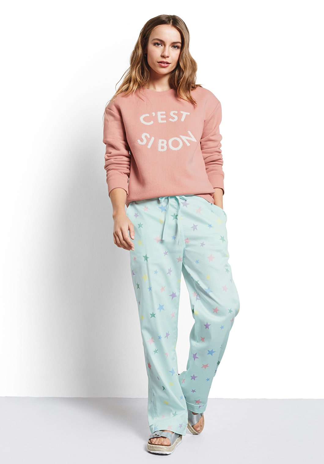 Model wears our Mint Green pyjama trousers with multi coloured pastel stars