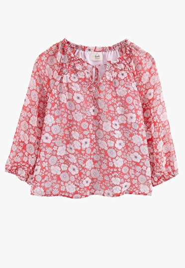 Semi fitted top with elbow length sleeves and v neck with drawstring tie detail in wild flower and hibiscus