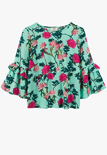 Printed top with bell sleeves with a ruffle trim in our ornate print in green