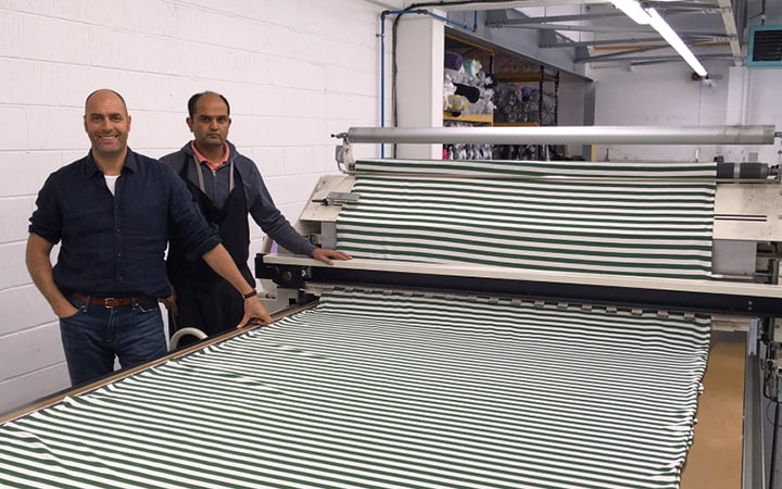 Neil with Lakha Modhavadia 'Laying' the fabric