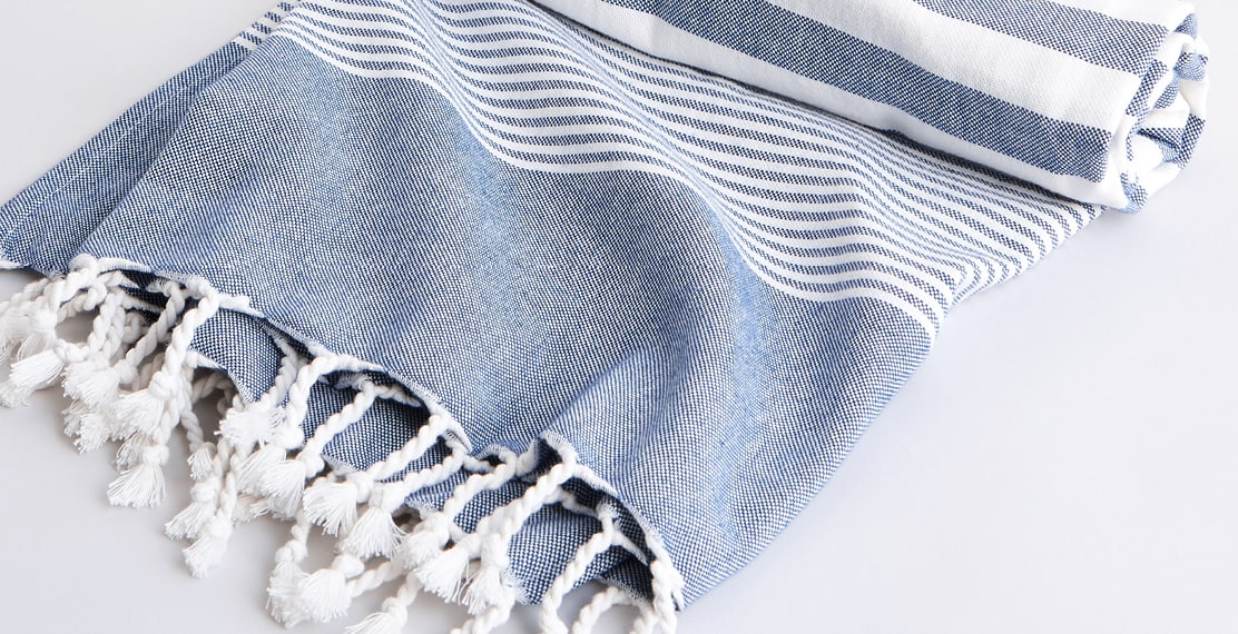 Close up shot of a blue and white striped towel