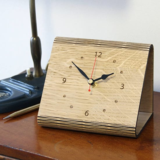 Image of the personalised living hinge clock on a bedside cabinet