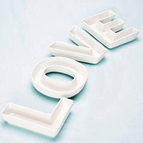 A Set Of 'Love' Ceramic Letter Dishes